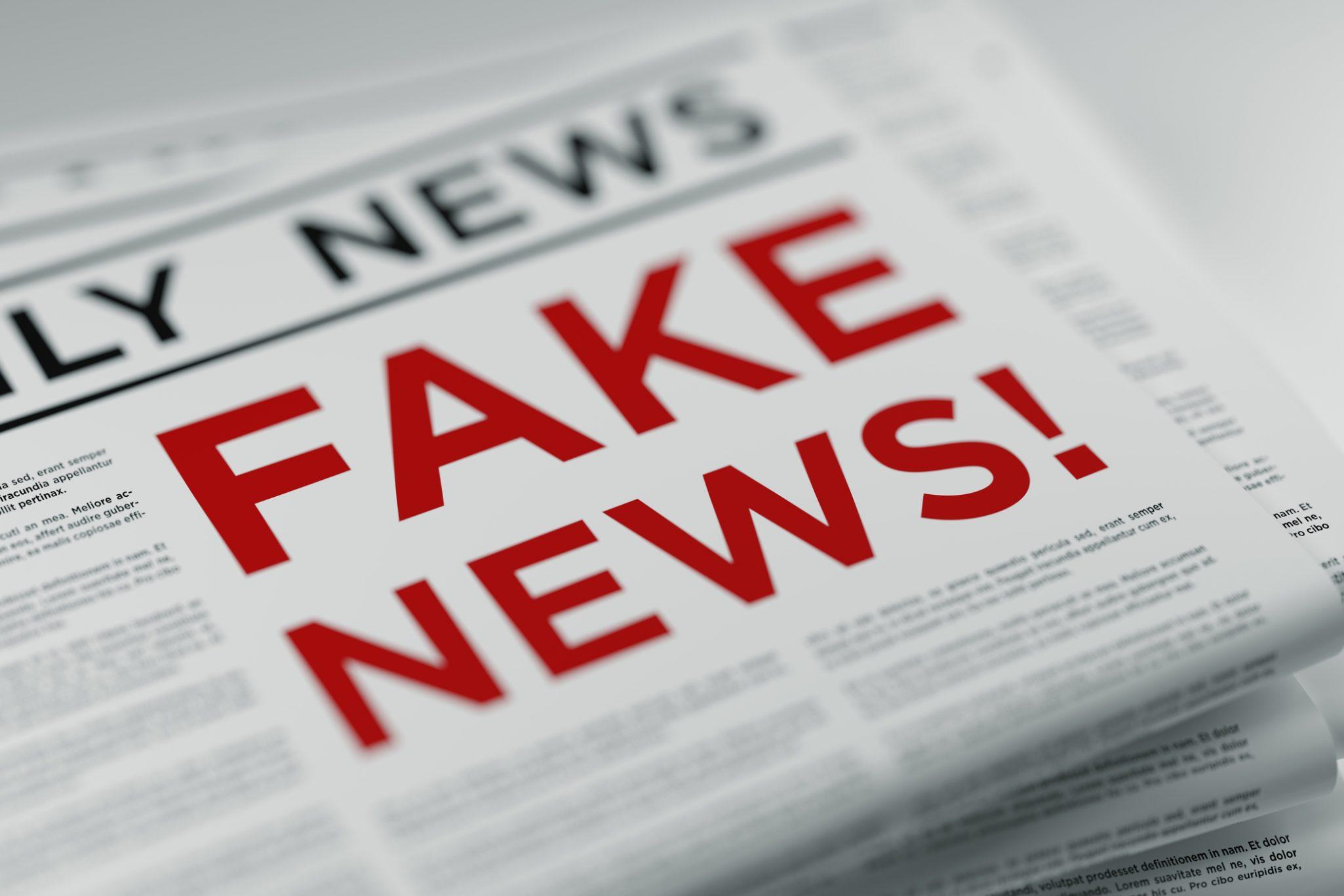 fighting fake news newspaper stack